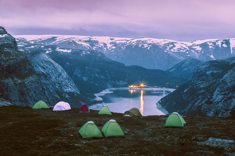 Night scene of camping site at Trolltunga travel destination